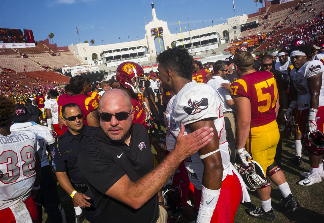 UNLV Rebels head coach Tony Sanchez leaves the field following after losing to the USC Trojans in a football game at the Los Angeles Memorial Coliseum in Los Angeles on Saturday, Sept. 1, 2018. U ...