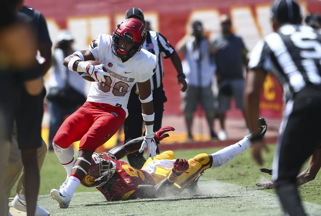 UNLV Rebels wide receiver Brandon Presley (80) is run out of bounds by USC Trojans cornerback Greg Johnson (9) during the first half of a football game at the Los Angeles Memorial Coliseum in Los ...