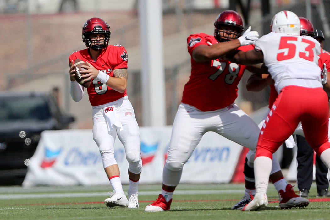 UNLV Rebels quarterback Max Gilliam (6) looks for an open pass against New Mexico Lobos during the first quarter of their football game at Sam Boyd Stadium in Las Vegas, Saturday, Oct. 6, 2018. Ne ...