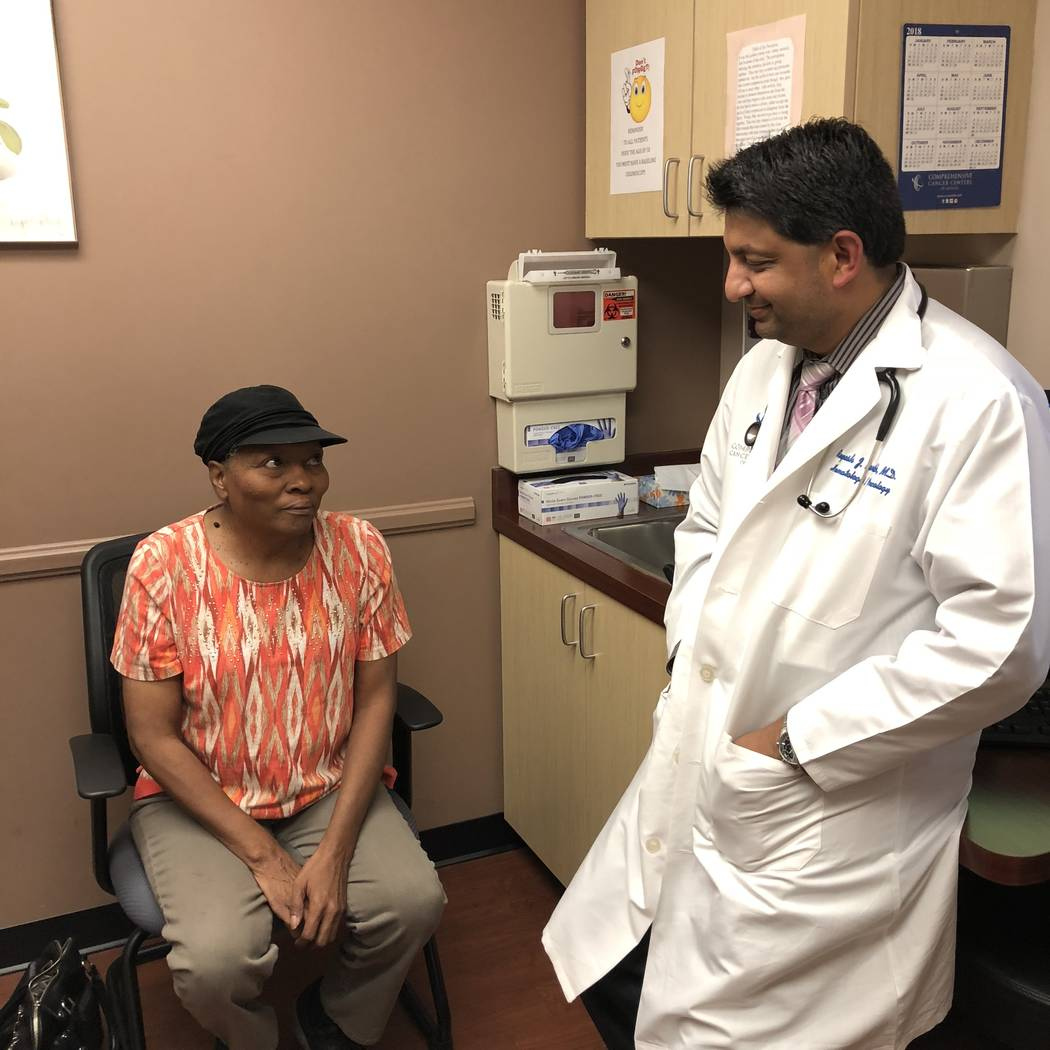 CCCN Breast cancer survivor Audrey Marrow consults with her oncologist, Dr. Rupesh Parikh, at Comprehensive Cancer Centers of Nevada.