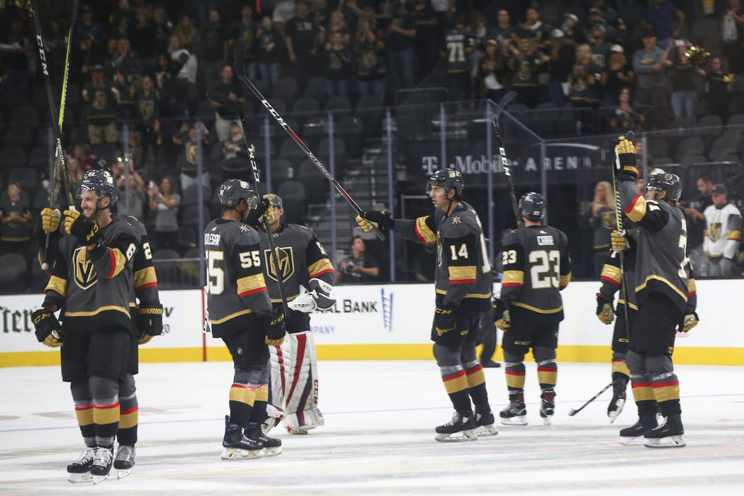Golden Knights players celebrate at the conclusion of a preseason NHL hockey game against the Arizona Coyotes at T-Mobile Arena in Las Vegas on Sunday, Sept. 16, 2018. Chase Stevens Las Vegas Revi ...