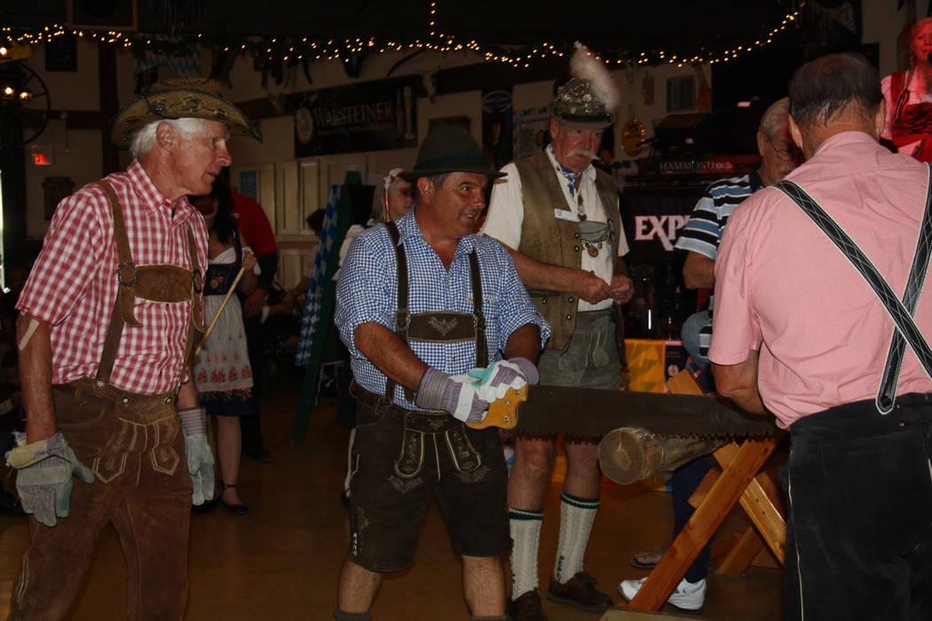 Besides bratwurst and beer, the Big Bear Lake Oktoberfest has plenty of competitions, including log sawing. (Deborah Wall/Las Vegas Review-Journal)