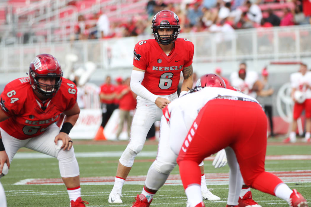 UNLV Rebels quarterback Max Gilliam (6) waits to snap the ball against New Mexico Lobos during the third quarter of their football game at Sam Boyd Stadium in Las Vegas, Saturday, Oct. 6, 2018. (E ...