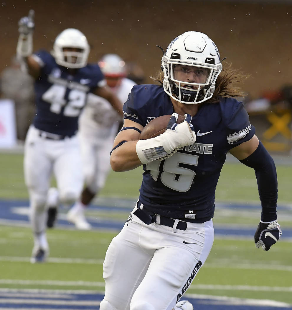 Utah State's Baron Gajkowski (15) returns a blocked punt 16 yards for a touchdown against UNLV during an NCAA college football game Saturday, Oct. 13, 2018, in Logan, Utah. (Eli Lucero/The Herald ...
