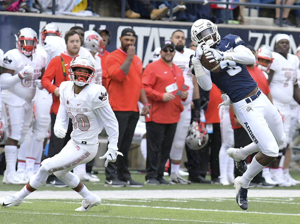 Utah State safety Jontrell Rocquemore (3) intercepts a pass intended for UNLV wide receiver Brandon Presley (80) during an NCAA college football game Saturday, Oct. 13, 2018, in Logan, Utah. (Eli ...