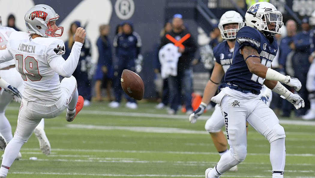 UNLV's Hayes Hicken (19) has hit punt blocked by Utah State's Deven Thompkins (19) during an NCAA collegefootball game, Saturday, Oct. 13, 2018, in Logan, Utah. (Eli Lucero/The Herald Journal via AP)