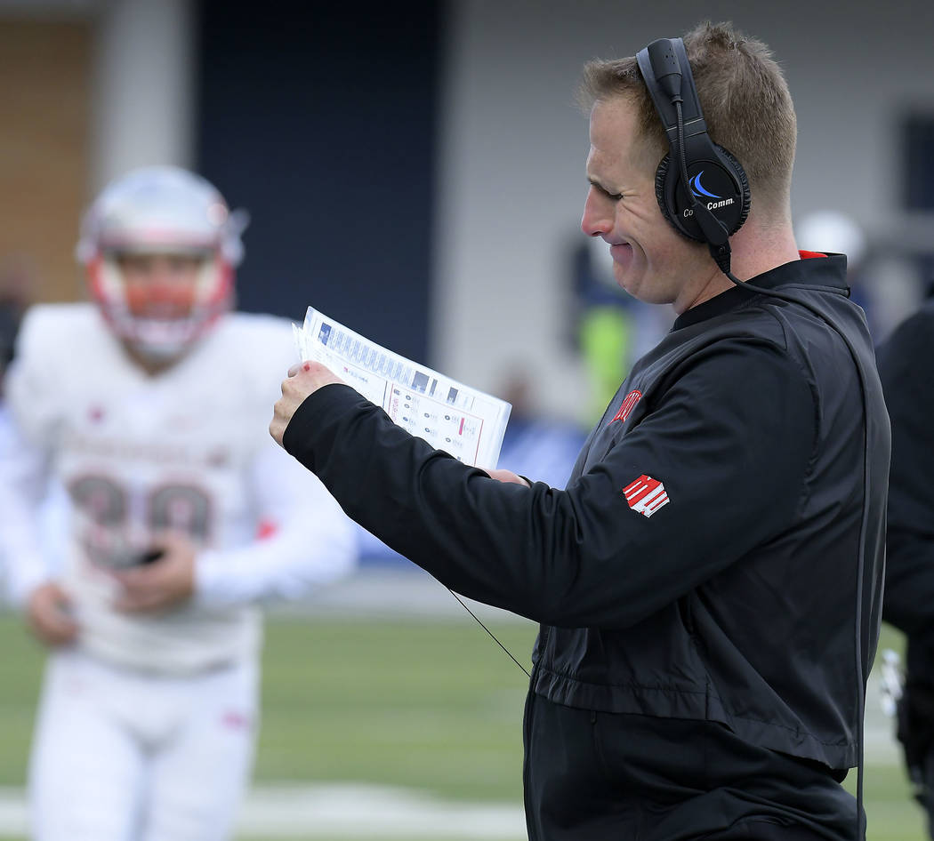 UNLV coach Tony Sanchez looks at his play sheet during a timeout in the team's NCAA college football game against Utah State on Saturday, Oct. 13, 2018, in Logan, Utah. (Eli Lucero/The Herald Jour ...