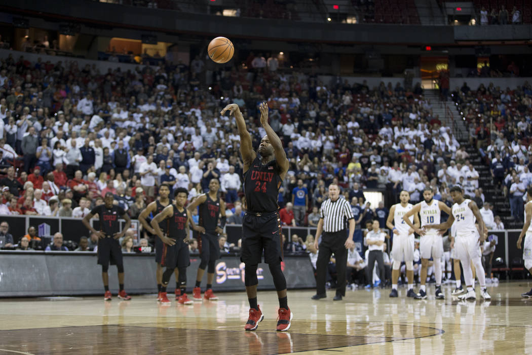 UNLV Rebels guard Jordan Johnson (24) shoots a free throw after a technical foul against Nevada Wolf Pack guard Hallice Cooke (13) in the second half of the Mountain West Conference men's basketba ...