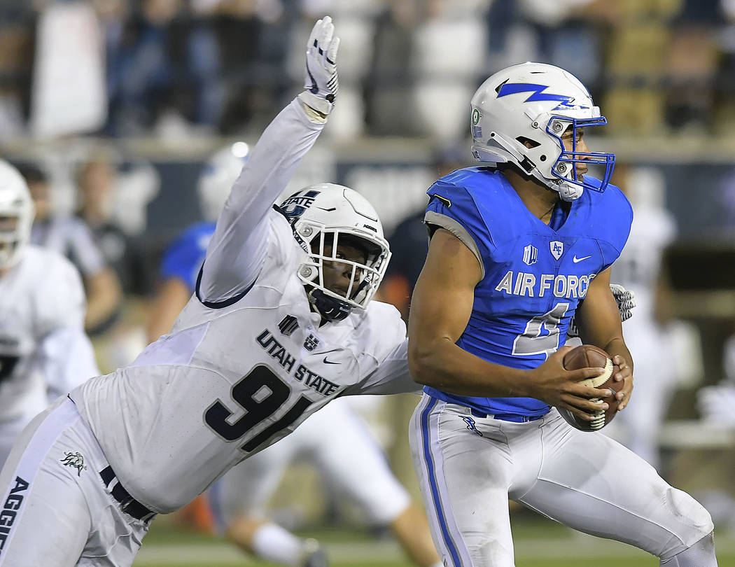Utah State defensive end Devon Anderson (91) tries to sack Air Force quarterback Isaiah Sanders (4) during an NCAA college football game, Saturday, Sept. 22, 2018, in Logan, Utah. (Eli Lucero/The ...