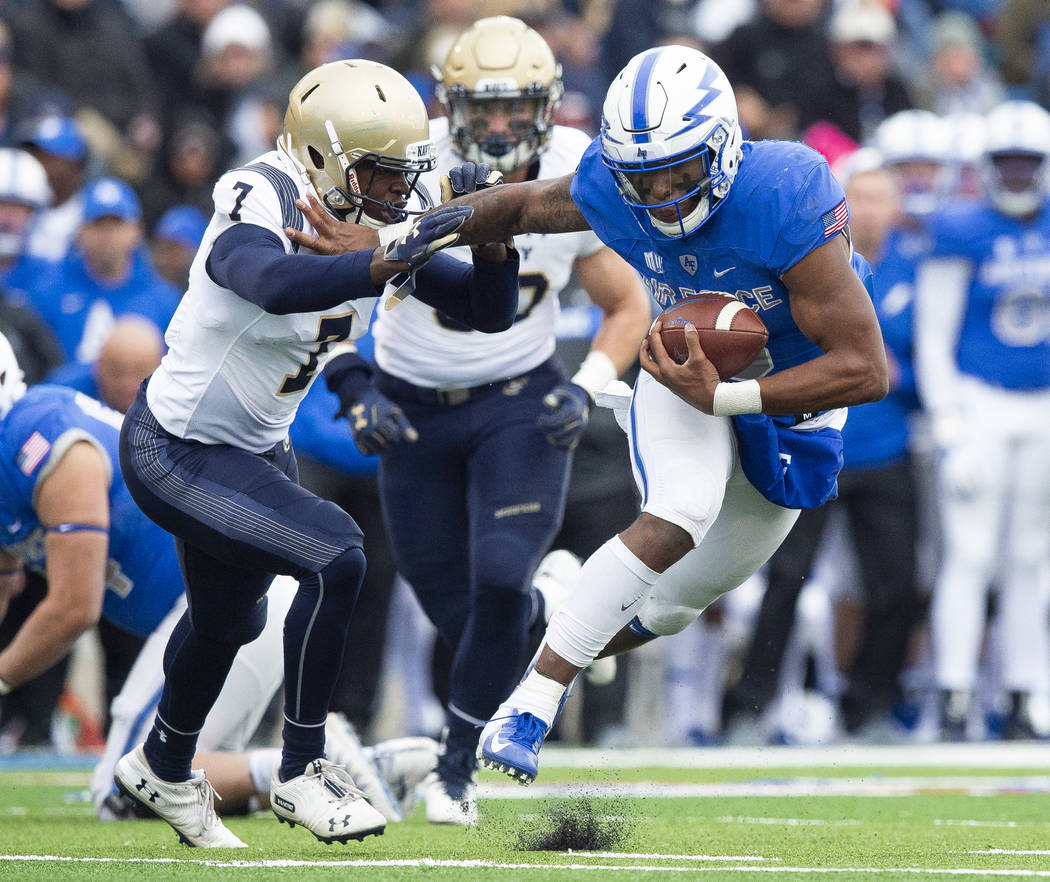 Air Force quarterback Isaiah Sanders (4) stiff-arms Navy cornerback Khaylan Williams (7) during an NCAA college football game at Falcon Stadium at the U.S. Air Force Academy, Saturday Oct. 6, 201 ...
