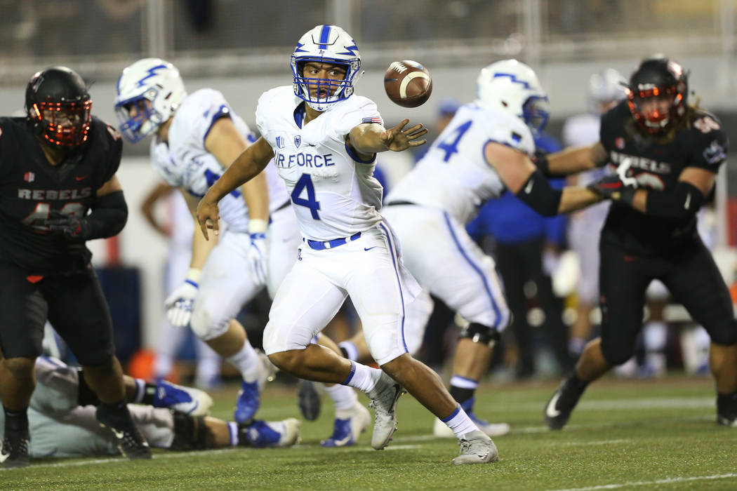 Air Force Falcons quarterback Isaiah Sanders (4) makes an under pass in the second quarter against UNLV Rebels at Sam Boyd Stadium in Las Vegas, Friday, Oct. 19, 2018. Erik Verduzco Las Vegas Revi ...