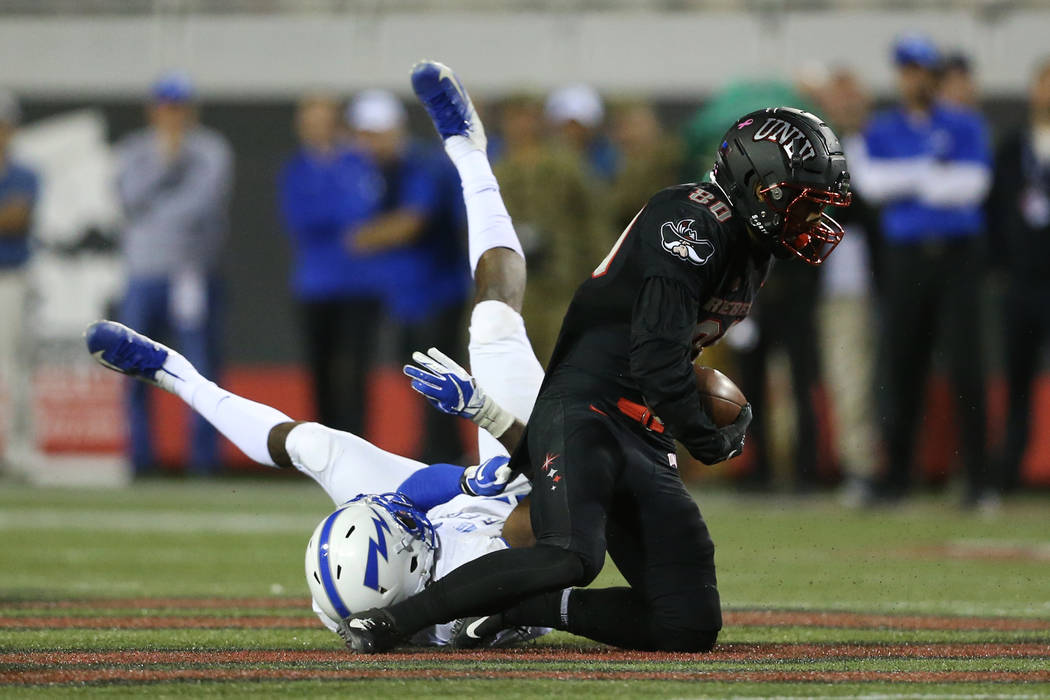 UNLV Rebels wide receiver Brandon Presley (80) makes a catch in the second quarter of the football game against Air Force Falcons at Sam Boyd Stadium in Las Vegas, Friday, Oct. 19, 2018. Erik Verd ...