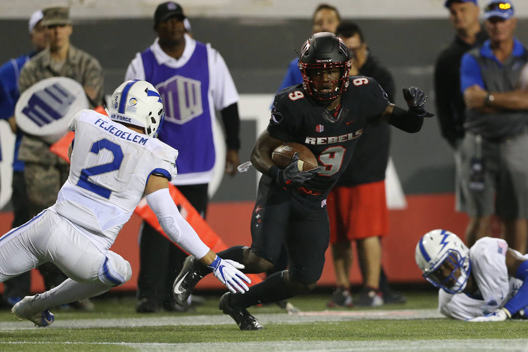 UNLV Rebels wide receiver Tyleek Collins (9) runs the ball against coverage from Air Force Falcons defensive back Jeremy Fejedelem (2) during the first quarter of the football game at Sam Boyd Sta ...