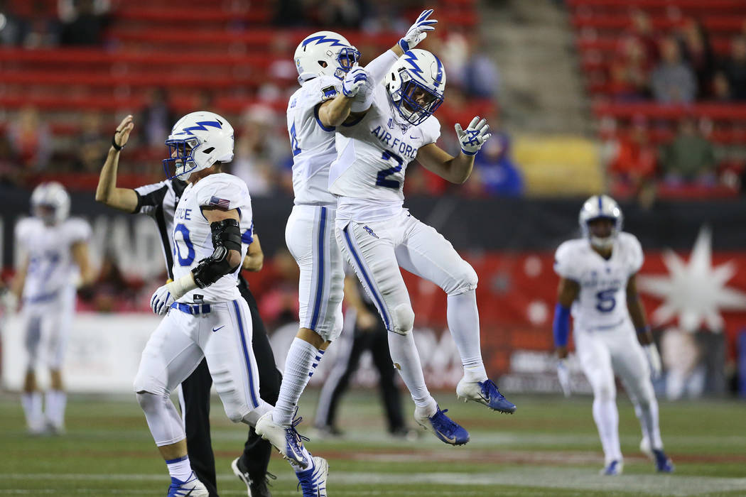 Air Force Falcons defensive back Jeremy Fejedelem (2) celebrates his interception against UNLV Rebels during the third quarter of the football game at Sam Boyd Stadium in Las Vegas, Friday, Oct. 1 ...
