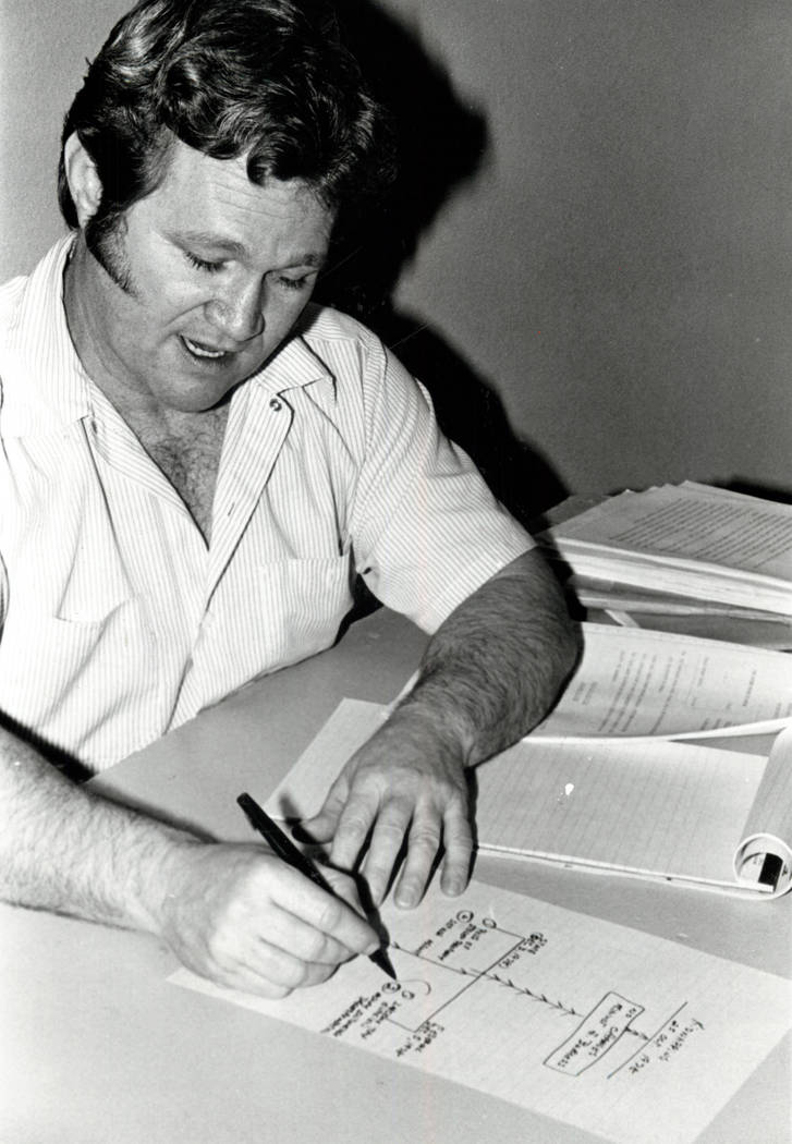 Jerald Burgess draws a diagram in 1982. (File Photo)