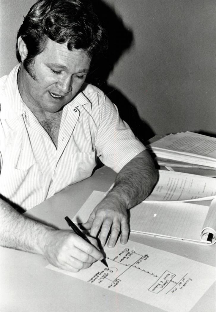 Jerald Burgess draws a diagram in 1982. (File Photo)