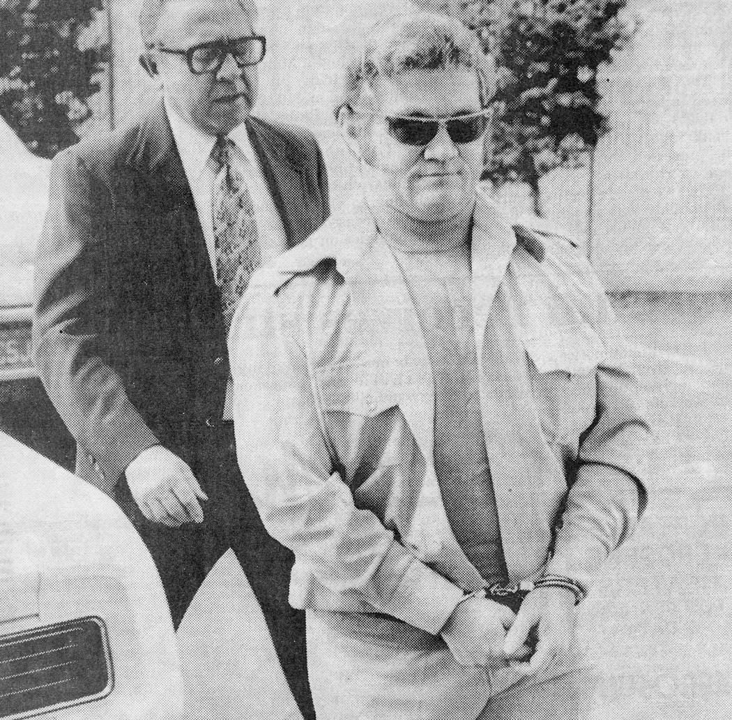 Jerald Burgess in handcuffs before his indictment in the 1978 kidnapping of 6-year-old Cary Sayegh. (File Photo)