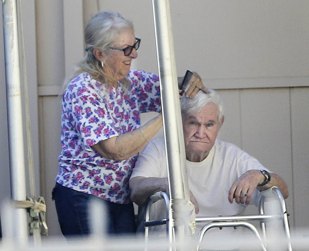 Jerald Howard Burgess, 81, gets his hair cut in the driveway of his Las Vegas home Thursday, Oct. 11, 2018. Burgess was indicted in the 1978 kidnapping of 6-year-old Cary Sayegh from the playgroun ...