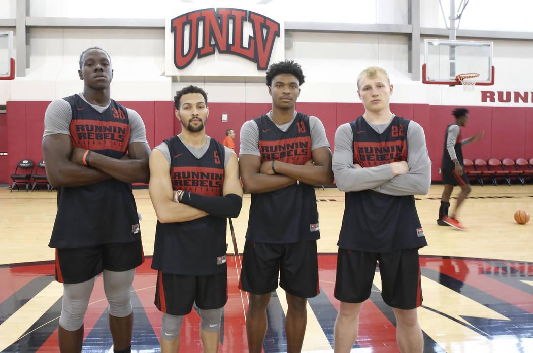 UNLV forward Jonathan Tchamwa Tchatchoua, left, guards Noah Robotham, Bryce Hamilton, and Trey Woodbury, right, pose for photo before team practice on Friday, Sept. 28, 2018, in Las Vegas. Bizuaye ...