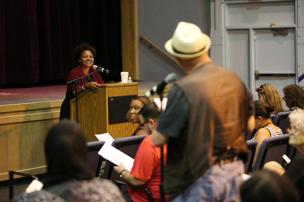 U.S. Poet Laureate Tracy K. Smith, left, listens to a comment during the Poetry Promise Reading Series at the Winchester Cultural Center in Las Vegas, Saturday, Sept. 29, 2018. Erik Verduzco Las V ...