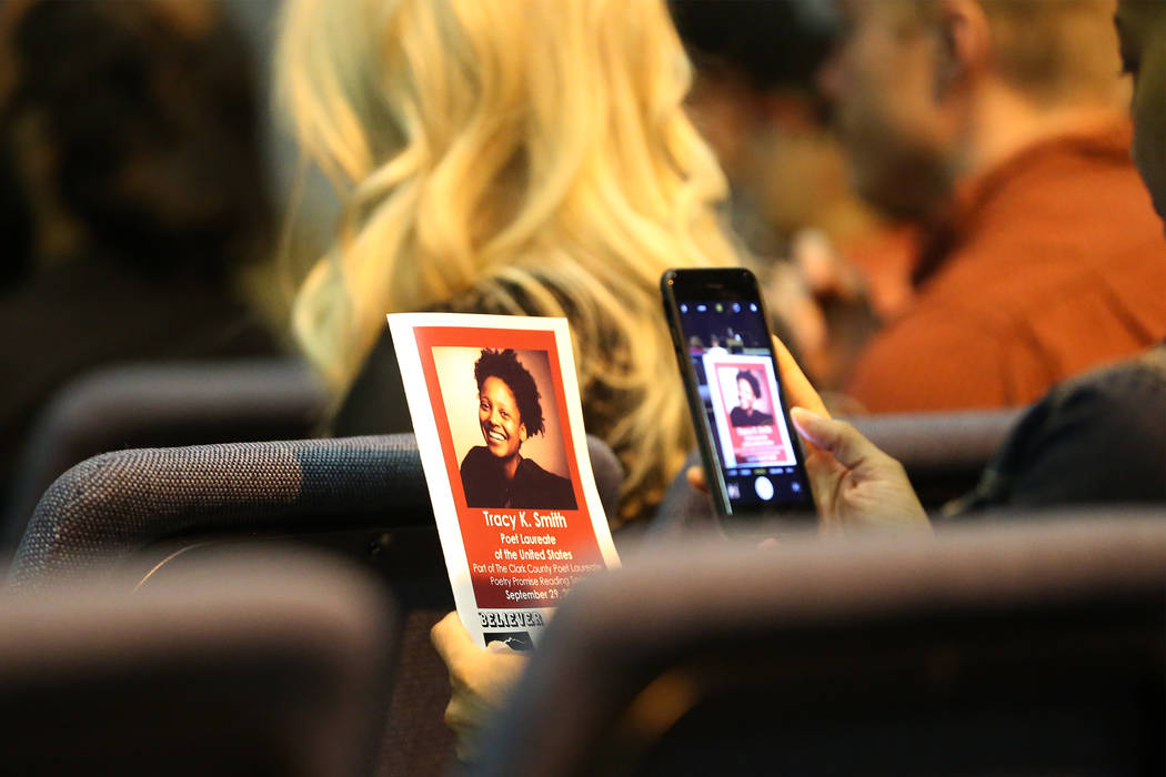 An person takes a photo of the program during the Poetry Promise Reading Series with U.S. Poet Laureate Tracy K. Smith at the Winchester Cultural Center in Las Vegas, Saturday, Sept. 29, 2018. Eri ...