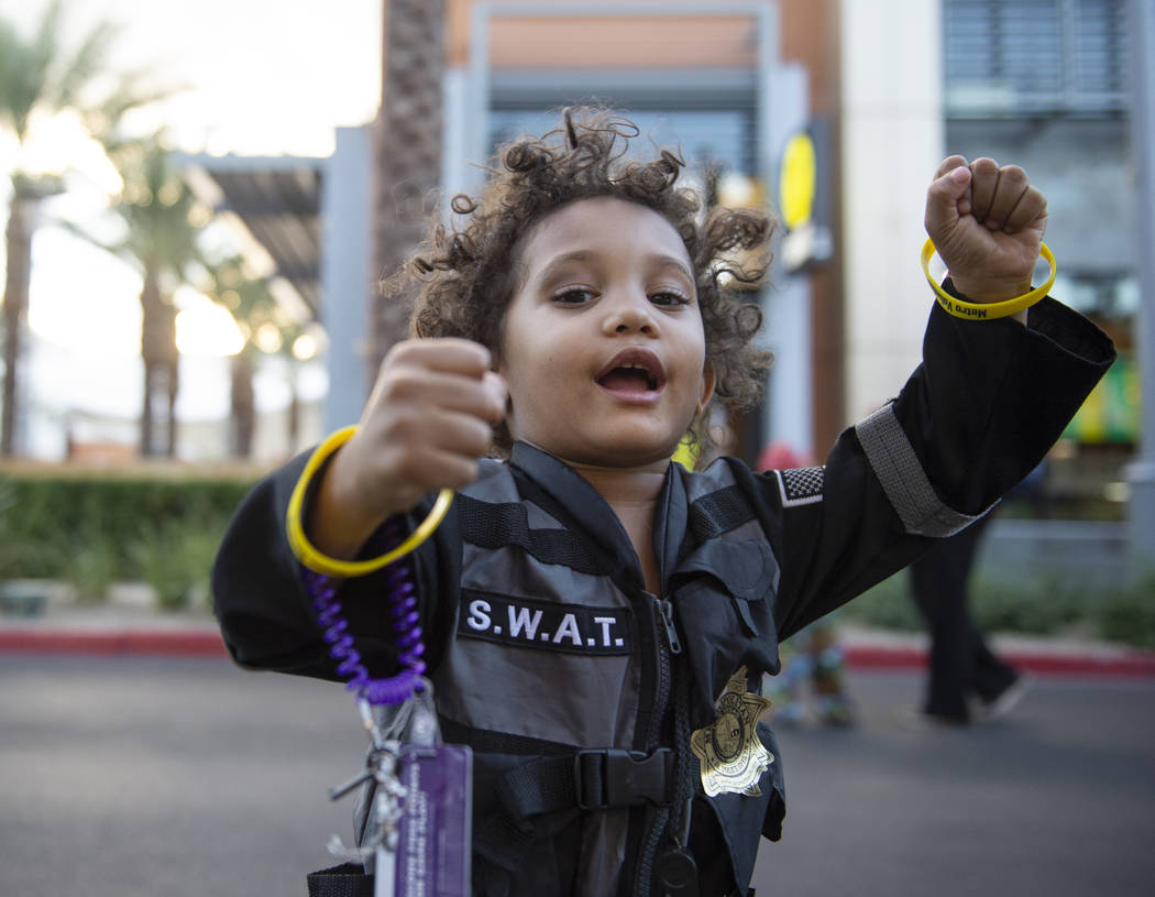 David Nelson, 3, poses for a photograph in his S.W.A.T. officer outfit at the LVMPD's National Night Out in the downtown Summerlin area of Las Vegas, Tuesday, Oct. 2, 2018. Caroline Brehman/Las Ve ...