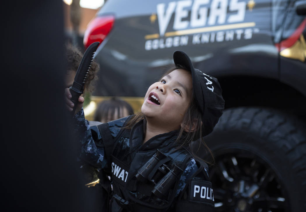 Hayle Isidro, 3, plays in her S.W.A.T. officer outfit at the LVMPD's National Night Out in the downtown Summerlin area of Las Vegas, Tuesday, Oct. 2, 2018. Caroline Brehman/Las Vegas Review-Journal