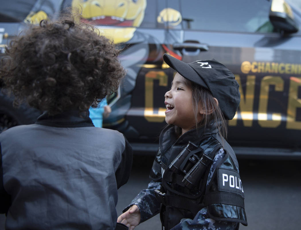 Hayle Isidro, 3, plays with David Nelson, 3, in her S.W.A.T. officer outfit at the LVMPD's National Night Out in the downtown Summerlin area of Las Vegas, Tuesday, Oct. 2, 2018. Caroline Brehman/L ...