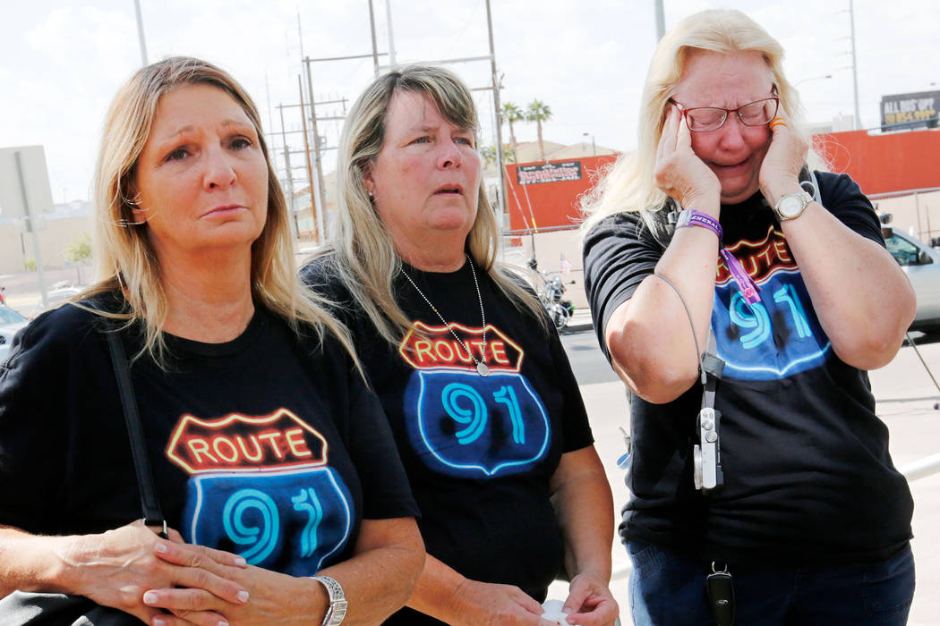 Linda Hazelwood, from left, Michelle Hamel and Jann Blake, all from Orange County, Calif. attend a prayer vigil in remembrance of Oct. 1 shooting victims in front of Las Vegas City Hall in Las Ve ...