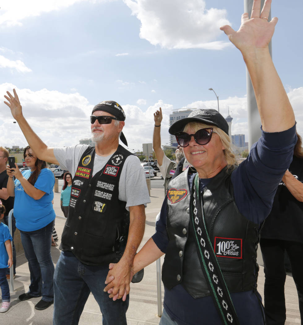 Paul Pilgrim of Boulder City and his wife Tina raise hands while a music band from International Church of Las Vegas (ICLV) performs during a prayer vigil in remembrance of Oct. 1 shooting victims ...