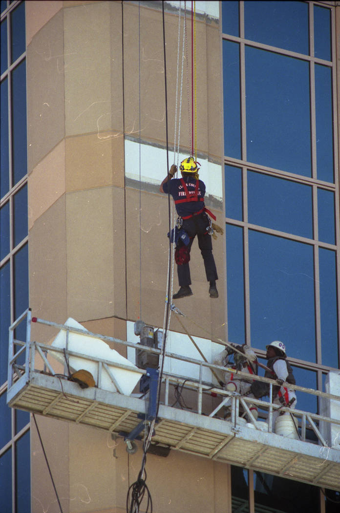 Construction workers are rescued in February 1999 after being stranded for more than two hours on a scaffold near The Venetian's 22nd floor. The scaffolding became stuck after winds cause the cabl ...