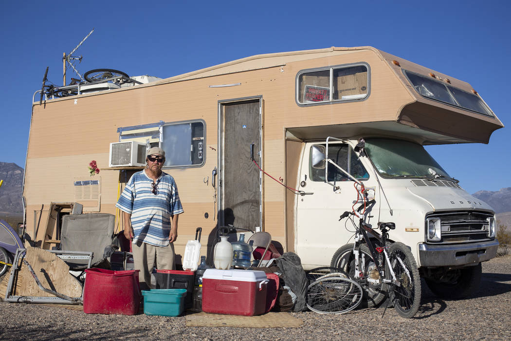 "Homeless resident Timothy Persson, 60, poses for a photograph outside of his trailer located on a vacant property west of the lot known as ""The Hill"" after being forced to relocate in Pa ..."