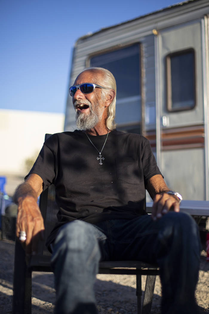 Homeless resident Rich enjoys a beverage outside of his trailer that sits on a lot west of the Nugget property where him and several others have temporarily relocated in Pahrump, Wednesday, Sept. ...