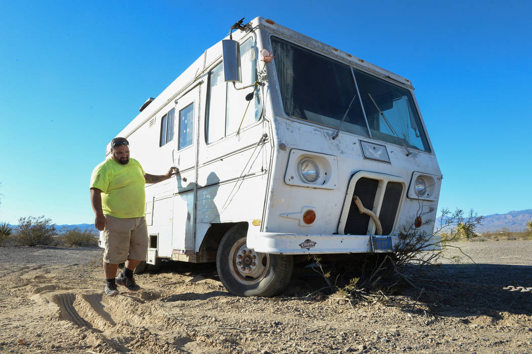 Jon Olivas of Platinum Hauling looks down at the bush Mary Supples' trailer got caught on while being pulled by Olivas' truck in Pahrump, Wednesday, Sept. 26, 2018. Caroline Brehman/Las Vegas Revi ...