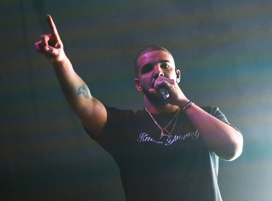 FILE - In a Saturday, March 19, 2016 file photo, Drake performs at the FADER FORT Presented by Converse during the South by Southwest Music Festival, in Austin, Texas. U2, Drake, Britney Spears an ...