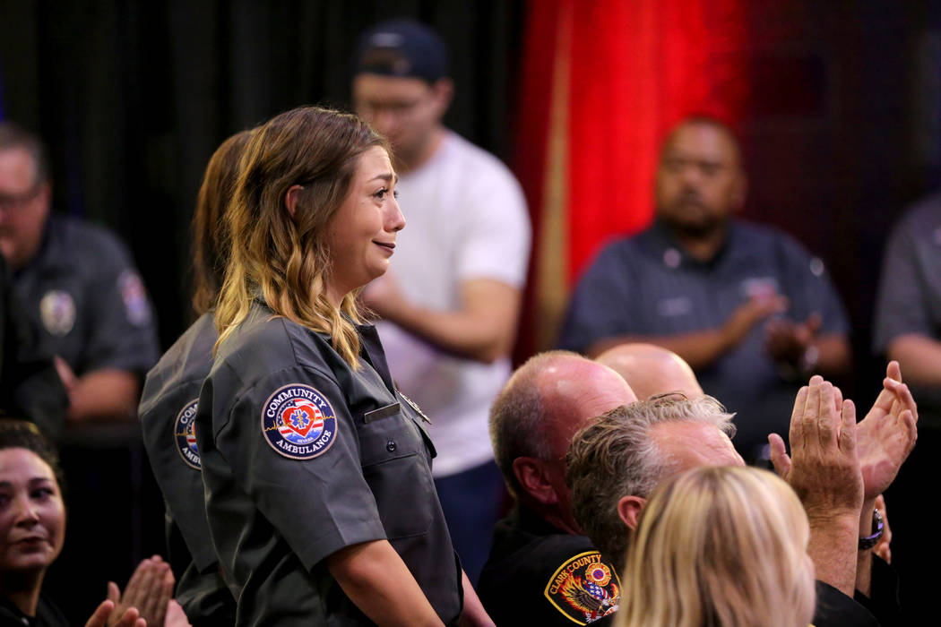 """Kaitlyn Rogers and fellow members of Community Ambulance, """"The 21,"""" are honored for their courage under fire, exceptional care for patients and resilience in the wake of the Route 91 festival shoo ..."""