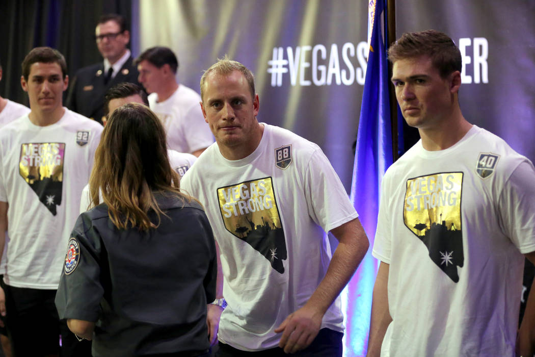 """Kaitlyn Rogers and fellow members of Community Ambulance """"The 21,"""" are honored by Vegas Golden Knights players for their courage under fire, exceptional care for patients and resilience in the wak ..."""