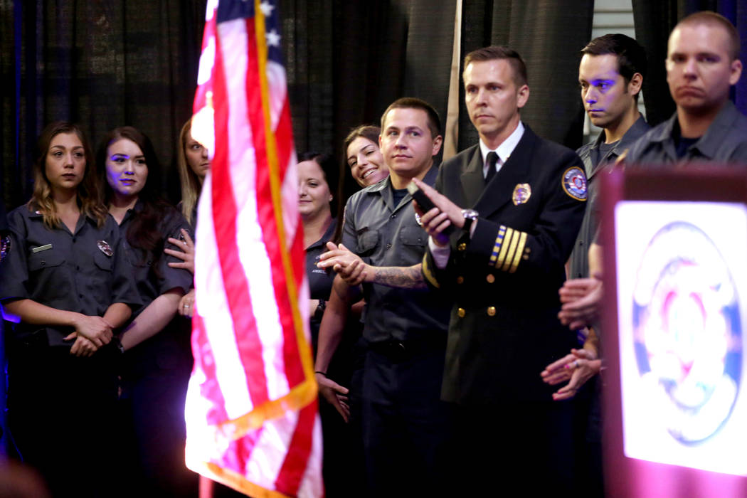 "Members of Community Ambulance ""The 21,"" are recognized during a ceremony honoring their courage under fire, exceptional care for patients and resilience in the wake of the Route 91 festival shoot ..."