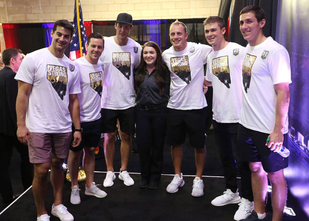 Randi Sloan, center, with Vegas Golden Knights players, from left, Max Pacioretty (67), Jonathan Marchessault (81), Brayden McNabb (3), Nate Schmidt (88), Ryan Carpenter (40) and Tomas Nosek (92), ...
