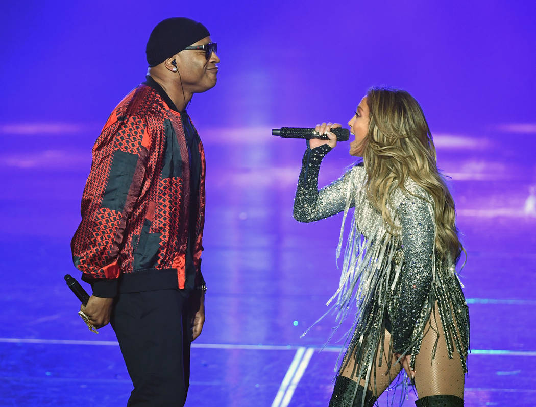 """LL Cool J and Jennifer Lopez perform during the finale of her residency, """"Jennifer Lopez: All I Have"""" at Zappos Theater at Planet Hollywood on the Las Vegas Strip, Sept, 29, 2018. (Ethan Miller/Ge ..."""