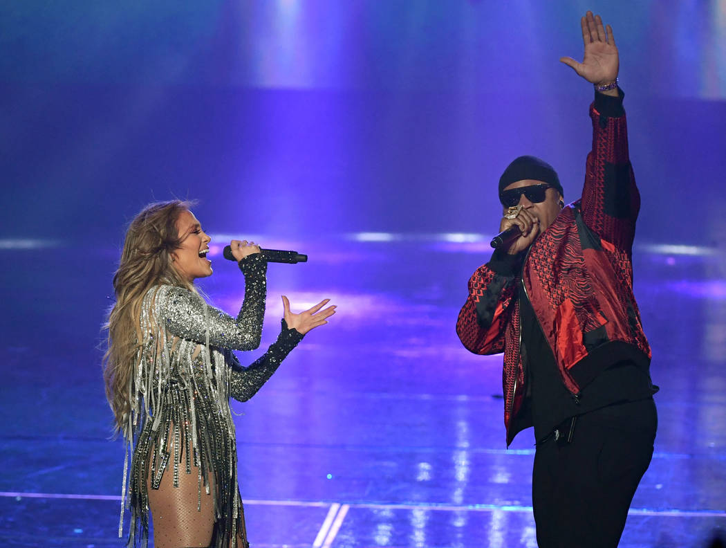 """Jennifer Lopez and LL Cool J perform during the finale of her residency """"Jennifer Lopez: All I Have"""" at Zappos Theater at Planet Hollywood on the Las Vegas Strip, Sept. 29, 2018. (Ethan Miller/Get ..."""