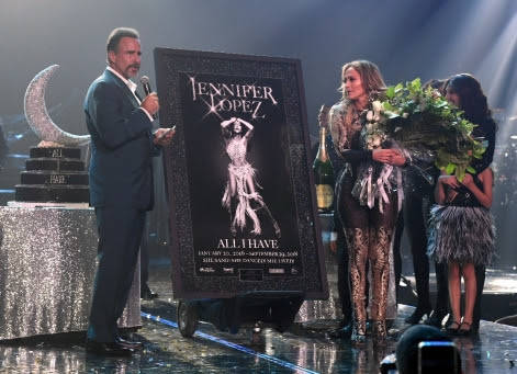"""Caesars Entertainment CEO Mark Frissora presents Jennifer Lopez a plaque of her promotional image as she closes """"Jennifer Lopez: All I Have"""" at Zappos Theater at Planet Hollywood on Sept. 29, 2018 ..."""