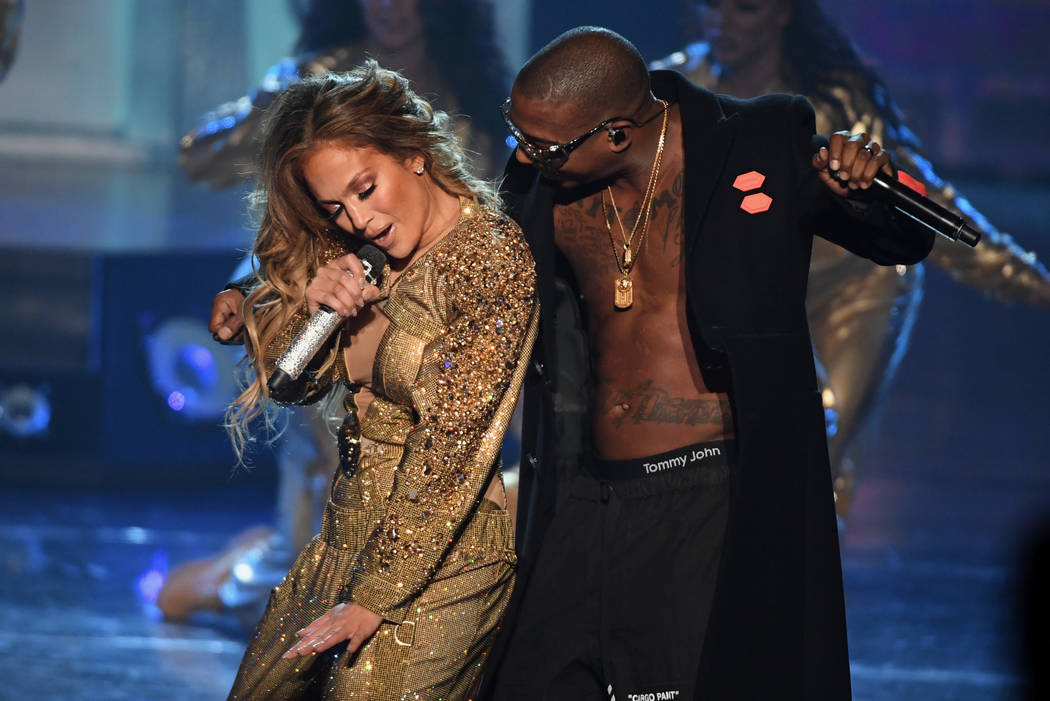 "LAS VEGAS, NV - SEPTEMBER 29: Jennifer Lopez (L) and Ja Rule forms during the finale of her residency, ""JENNIFER LOPEZ: ALL I HAVE"" at Zappos Theater at Planet Hollywood Resort & Ca ..."