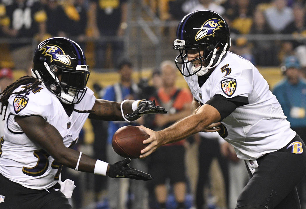 93be2c44a Baltimore Ravens quarterback Joe Flacco (5) hands off during the first half  of an