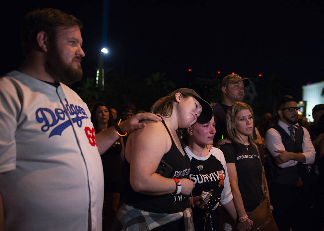 Brittany Maldonado, left, and Alaina Laswell cry as they recount the One October shooting a year later outside of the lot where the shooting occurred in Las Vegas, Monday, Oct. 1, 2018. Caroline B ...