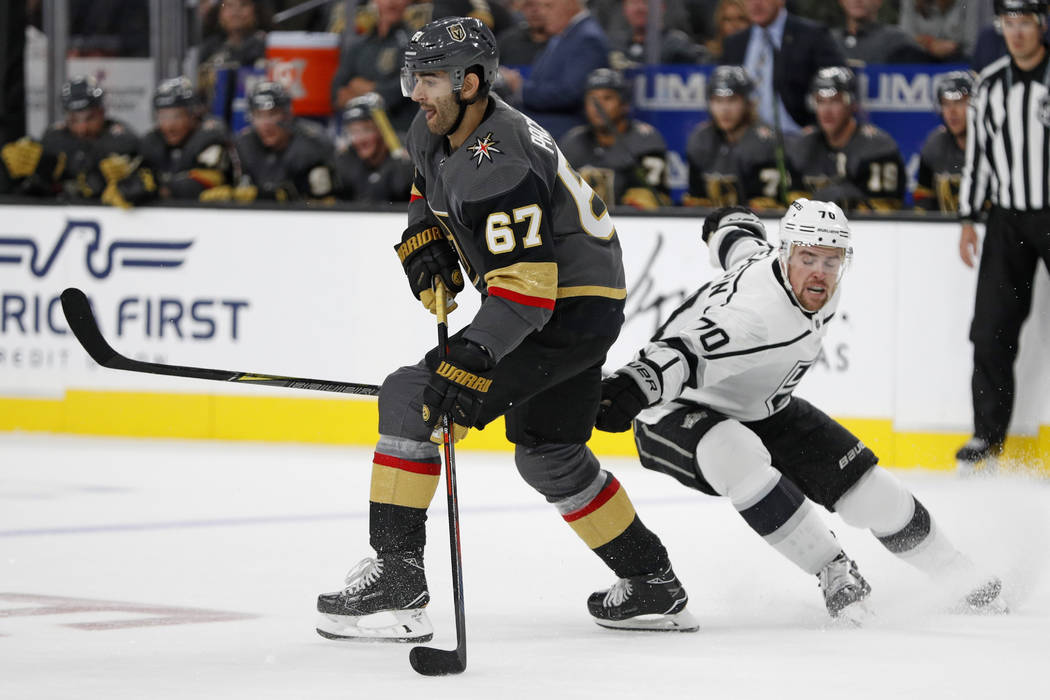 Vegas Golden Knights left wing Max Pacioretty (67) skates around Los Angeles Kings left wing Tanner Pearson during the third period of a preseason NHL hockey game Friday, Sept. 28, 2018, in Las Ve ...