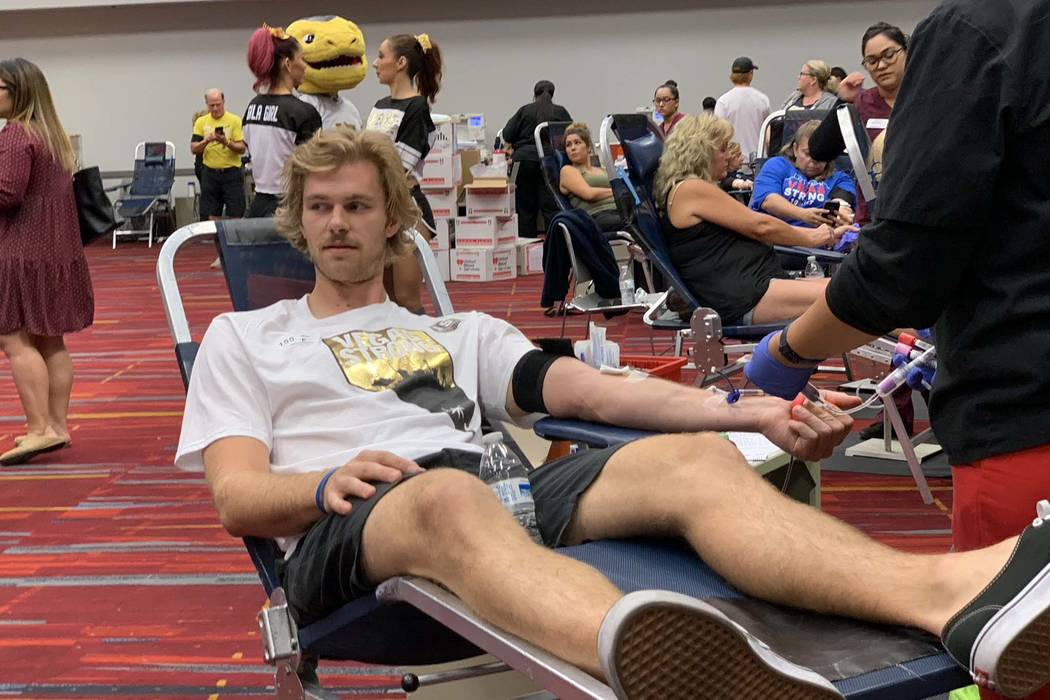 Jon Merrill, a member of the Vegas Golden Knights, donates blood during the Vitalent blood drive at the Las Vegas Convention Center on the one-year anniversary of the Las Vegas shooting, Oc.t 1, 2 ...