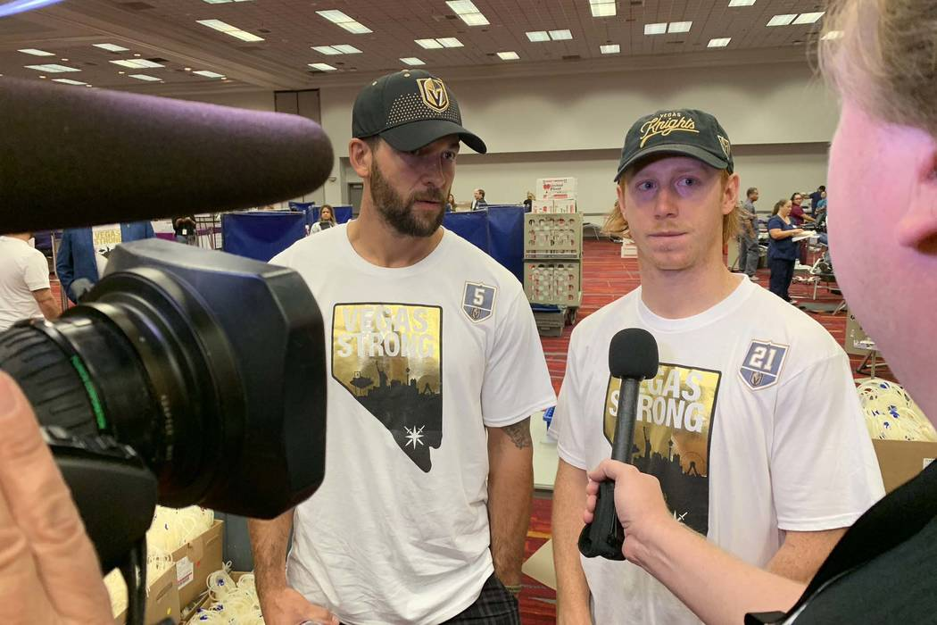 Deryk Engelland, left, and Cody Eakin of the Vegas Golden Knights arrive to take part in the Vitalent blood drive at the Las Vegas Convention Center on the one-year anniversary of the Las Vegas sh ...