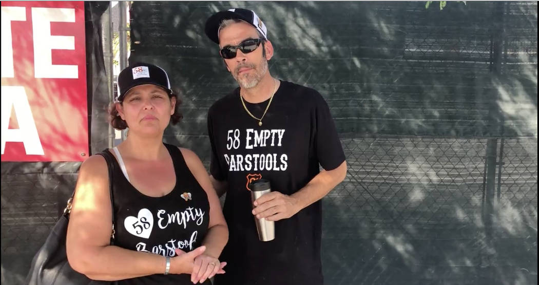 Local shooting survivors Jackie Baren, left, and Robert Baren stand outside the East entrance/exit gate of the festival grounds on Monday, Oct. 1, 2018, in Las Vegas remembering their escape from ...