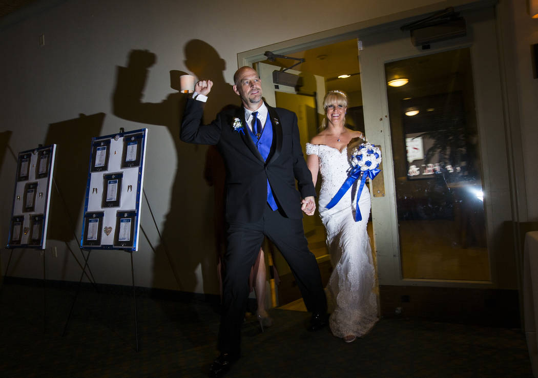 Todd and Oshia Wienke make their grand entrance for their wedding reception at Tahiti Village in Las Vegas on Monday, Oct. 1, 2018. Todd was shot three times as he shielded Oshia soon after the sh ...